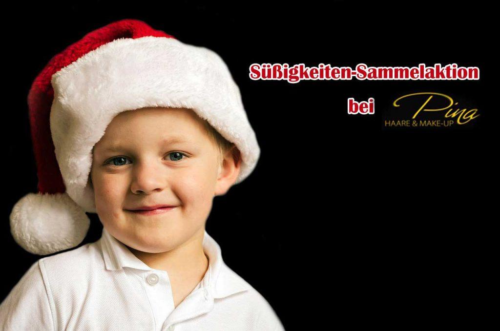 Kleiner Junge mit Weihnachtsmütze, Text: Süßigkeiten Sammelaktion